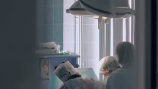 Plastic surgeons busy with completing the operation