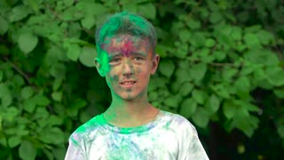 Portrait of young boy disarranging his hair and holy powder falls out of his hair