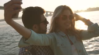 Romantic woman and man in love taking sharing photo