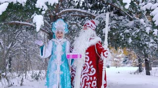 Smiling Ded Moroz Father Frost and Snegurochka Snow Maiden holding New Year gift