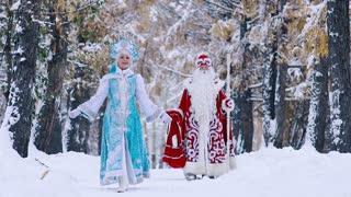 Smiling Snow Maiden spinning around while walking with Father Frost