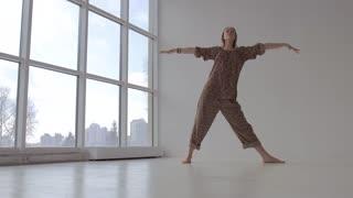 Sporty yoga woman practicing yoga poses in studio