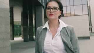 Stylish business woman walking along business centre