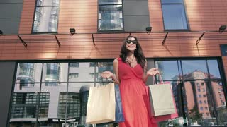 Three female friend meeting outdoors after shopping