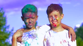 Two boys being attacked with holy powder in front of the camera