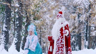 Two fairy-tale characters enjoying the time in snowy forest