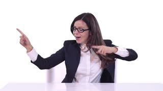 Beautiful brunette with glasses sitting in a business suit at office Desk and enjoys a successful career. White background.