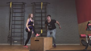 Crossfit fitness workout group woman and man at gym