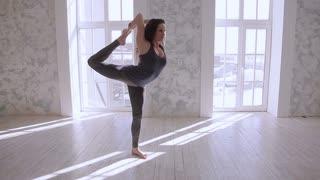 Girl doing stretching. Do the splits
