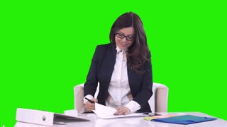 Good deal. Happy smiling young business woman in a business suit shows thumb on the camera. Green background