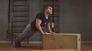 Gym man push-up strength pushup in a fitness workout