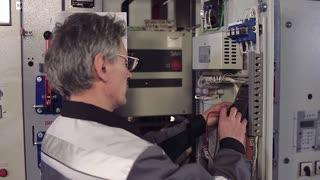 Man installing electric meter.