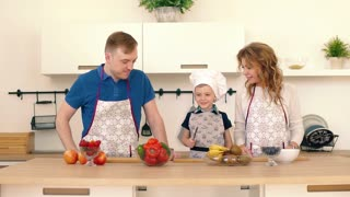 Mom and Dad help you prepare breakfast for your son.