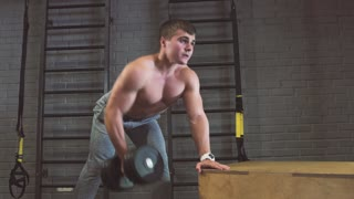 Sport, fitness, lifestyle and people concept - man with dumbbells exercising in gym
