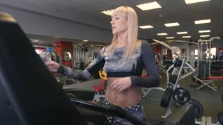 Woman runs on treadmill at the fitness centre