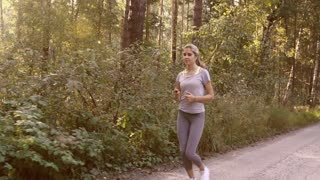 Young woman is running in the morning to keep fit