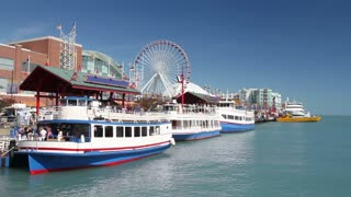 Ferries boarding at the famous Navy Pier at Lake Michigan in Chicago on a clear summer day