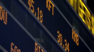 Large scrolling LED stock ticker shows stock market developments