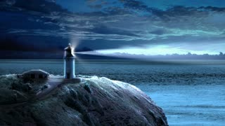 Looping animation with a lighthouse beaming light out to sea at night as the clouds float by