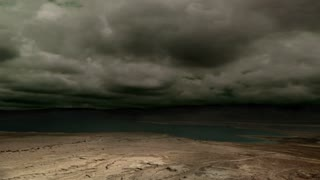 Ominous clouds and lightning over a desert plain (composited with the Dead Sea)