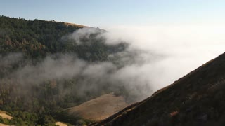 Time lapse of fog rolling in over the hills at the Big Sur in California