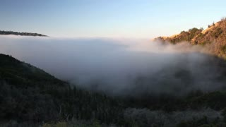 Time lapse of fog rolling in over the hills at the Big Sur in CaliforniaFog Rolling In.mov