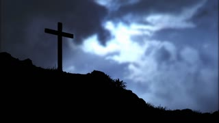 Time lapse of the sun shining through clouds passing over a cross on a hill