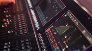Audio mix desk at a concert. Man working on professional digital audio channel mixer in studio. Male Dj hands playing set in night club party slow motion