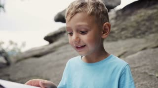 Boy in the mountains reading a book 4k