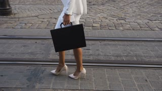 Busines women goes to a sity with a briefcase slow motion