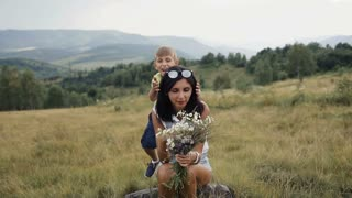 Children play with my mom in the mountains a fun family slow motion