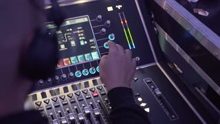 DJ mixing music during a disco party. Dance, music, night out concept slow motion