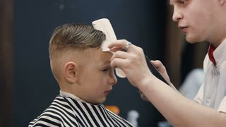 Hairdresser Making Hair Cut For Little Boy Machine Barber Cutting