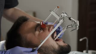 Installation of the face-bow. Modern technology. Dental clinic 4K
