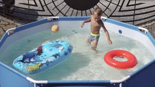 Kids are fun playing in the water and swim slow motion