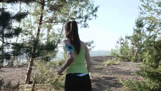 Rear view. Mountain landscape. Caucasian running girl. Jogging in the morning at forest in mountains. Athletic run, slow motion