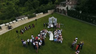 The father carries his daughter to the altar where her fiance waits. Wedding day slow motion