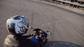 The young biker rides on his motorcycle slow motion