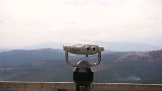 Tourist telescope look at mountains in the Bukovel. Coin operated binocular slow motion