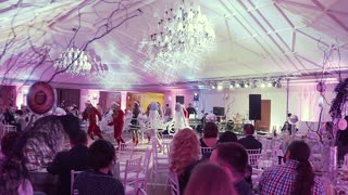 UKRAINE, LVIV - JAN 18, 2018: The dance group dances at a disco party in a restaurant. Speech of the dance group at the disco party slow motion