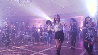 UKRAINE, LVIV - JAN 18, 2018: The dance team dances at the in the disco party 80's at the restaurant disco ball party. Corporate party of company employees. Speech by dance group at disco party slow