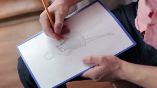 A creative designer working on a fashion project at home