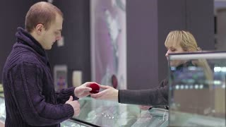 A man buys a wedding ring for the bride