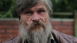 A portrait of an old homeless man, close-up