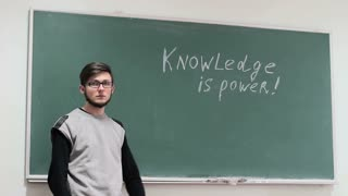 A student on the background of a blackboard. Educational concept