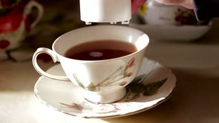Adding a sweetener to a cup of tea. Diet and weight loss