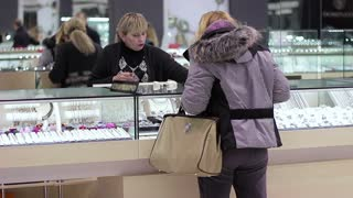 Adult woman buys jewelry and communicates with the seller