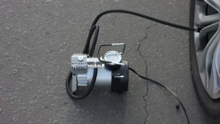 Air compressor for car wheels in working position for pump.