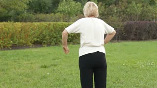 Back pain in an elderly woman while exercising