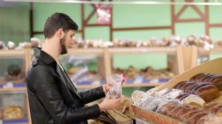 Bakery. buyer buying bread in the supermarket